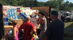 Volunteers Unload Relief Goods from Truck - stock footage