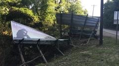 Roadside Billboards Washed Down by Flood Waters - stock footage