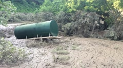 Fuel Storage Tank Standing on End Due to Flood Damage Stock Footage