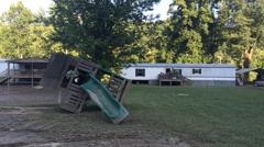 Children's Playground Overturned by Flood Damage Stock Footage