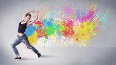Young colorful street dancer with paint splash - stock photo