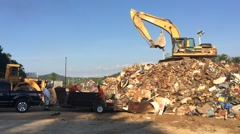 Loader and Backhoe Pile Ruined Household Goods Stock Footage