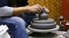 artisan man demonstrating how to make clay pot - stock footage