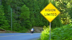 4K Vision Limited Yellow Traffic Warning Sign with Vehicles in Background - stock footage