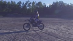 Motocross female rider driving dirt bike Stock Footage