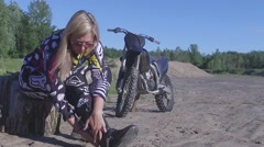Pretty puts on dirtbike motocross boots slow motion Stock Footage