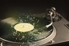 Turntable playing classical music with icon drawn instruments - stock photo