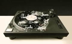 Turntable with vinyl and music genres writen - stock photo