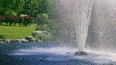 Garden fountain. Fountain splash in slow motion. Water fountain in summer park Stock Footage