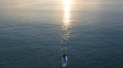 Aerial Shot of People Stand up Paddle Surfing at Sunset Time. Stock Footage