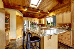 Kitchen with granite counter top and tile floor - stock photo