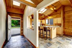Hallway with opened door and tile floor. View to backyard. Opened plan kitche - stock photo