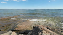 Stockholm archipelago - timelapse of waves lapping Baltic Sea coast rocks. Stock Footage