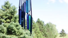 Stained glassed chimes swinging in the wind Stock Footage
