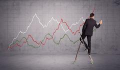 male on ladder drawing chart lines - stock photo