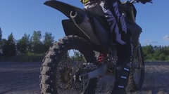 Motocross female rider takes off in slow motion Stock Footage