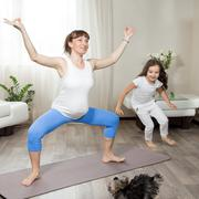 Family healthy lifestyle concept. Pregnancy Yoga and Fitness. Young happy pre Stock Photos