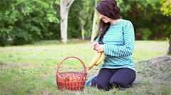 Young girl gets bananas fruit baskets Stock Footage