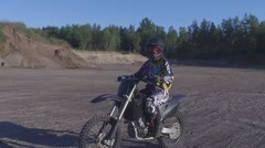 Dirtbike motocross girl gives camera the middle finger slow motion Stock Footage