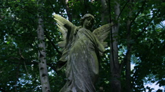Timelapse Statue headstone in cemetery Stock Footage