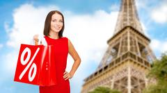 woman with shopping bags over paris eiffel tower - stock photo
