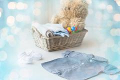 close up of baby clothes and toys for newborn - stock photo