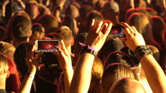 Fans shoot a video rock concert on mobile phones. Stock Footage