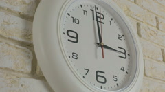 Time three hour. Timelapse. Round white clock hanging on brick wall Stock Footage