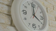 Time four hour. Timelapse. Round white clock hanging on brick wall - stock footage