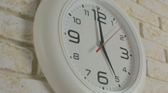 Time five hour. Timelapse. Round white clock hanging on brick wall Stock Footage