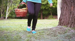 Girl with fruit basket looking for a place to have a picnic Stock Footage