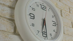 Time six hours thirty minutes. Timelapse. Round white clock hanging on brick Stock Footage