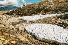 Beautiful Landscape Of Norwegian Mountains. Summer Snow. Nature - stock photo
