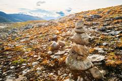 Stack Of Stones On Norwegian Mountain, Norway Nature. Travel And Stock Photos