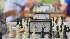 chess tournament clock in the park on a summer day - stock footage