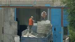 Two handymen are working in the back of a truck. Workers prepare to unload cargo - stock footage