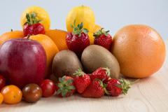 Mix fruits background.Healthy eating, dieting concept, clean eating. Stock Photos