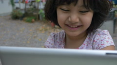 4K : Happy Asian girl watching cartoon on digital tablet - stock footage