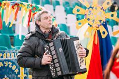 Unknown man plays the accordion folk Belarusian music at Celebra Stock Photos