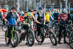 Young men cyclists in sportswear for cycling on fat tires bikes Stock Photos