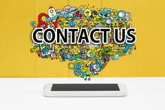 Contact Us concept with smartphone Stock Photos