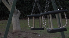 Empty swing moving: sadness, loneliness, abandonment Stock Footage
