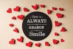 There is Always Reason to Smile  message with small hearts - stock photo