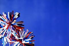 4th of July decorations on blue background - stock photo