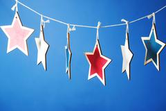 4th of July decorations on blue background Stock Photos