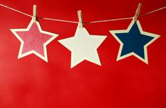 4th of July decorations on red background - stock photo