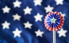 4th of July decorations on American flag background - stock photo