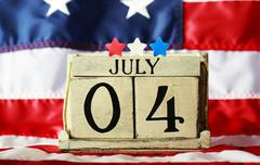 4th of July theme with wood block calendar - stock photo