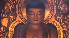 Buddha image through the smoke from the burning incense in Xian, China. Stock Footage