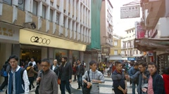 Pedestrian traffic in Macau's downtown business district Stock Footage